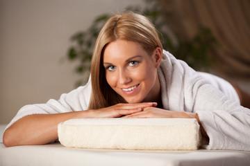 Happy woman relaxing in spa