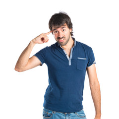 Man making crazy gesture over white background