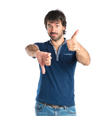 Man doing a bad signal over white background