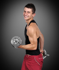 muscular man lifting dumbbells
