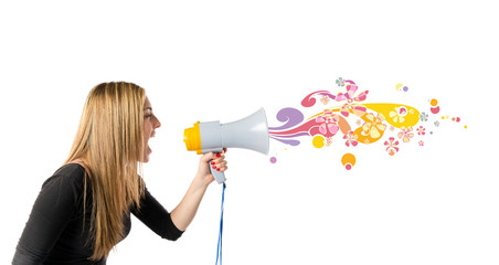 Pretty girl shouting with a megaphone over white background