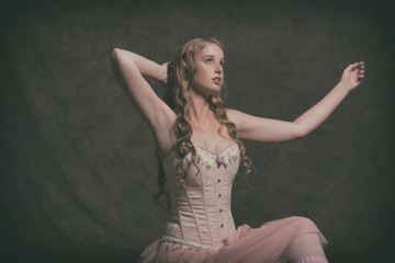 Sensual vintage ballet fashion woman wearing pink corset and dre