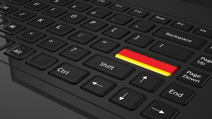 Black keyboard with German flag on enter