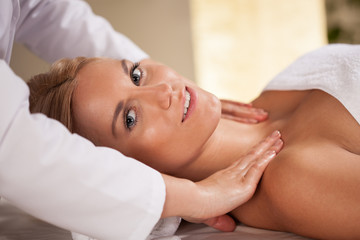Woman during neck massage