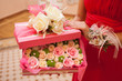 flowers in a pink box
