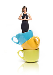 Zen woman inside coffee cups over white background.