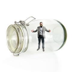 Businessman with gas mask inside glass jar
