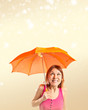 Girl holding an umbrella over ocher background