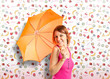 Girl holding an umbrella over cute background