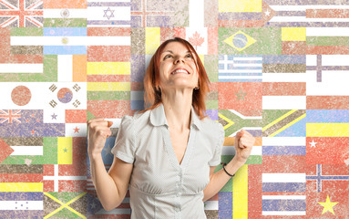 Lucky woman over flags background