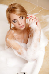 Woman in bath relaxing. Closeup of young woman in bathtub bathin