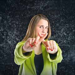 Girl doing NO gesture over black background