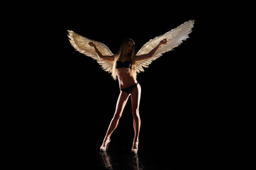 angel with wings on black background
