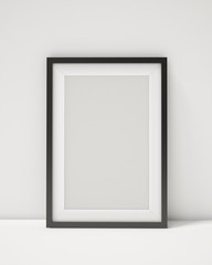 blank black picture frame on the white interior