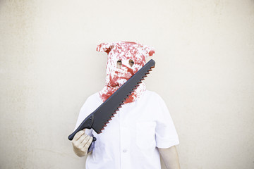 Murderer with hooded Saw
