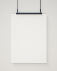 blank white hanging poster on white wall