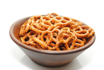 A Brown Wooden Bowl filled with Delicious Pretzels
