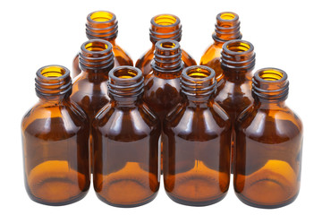many little open brown glass pharmacy bottles