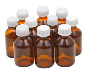 many small closed brown glass pharmacy bottles