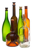 side view of several empty closed wine bottles