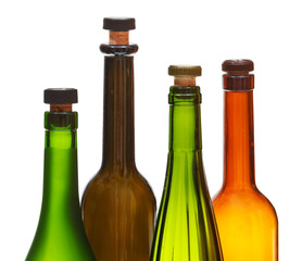 four empty closed wine bottles close up