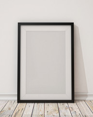 blank black picture frame on the wall and the floor
