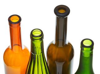open bottlenecks of colored wine bottles close up