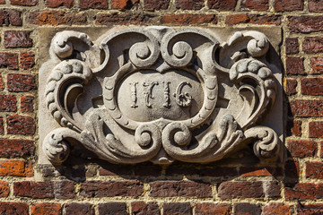 Art decor on old brickwork in Brugge, Flanders, Belgium