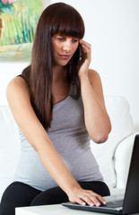 Pregnant woman calling on mobile phone