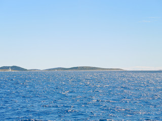 Adriatic Sea in Dalmatia under blue sky