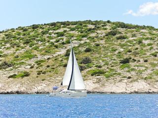 white yacht sailing near Dalmatia coast