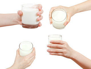 set of hand holding glass of milk isolated