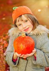 Autumn girl in pumpkin hat
