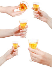 set of hand holds little glass of dessert wine