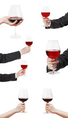 set od red wine glasses in hand