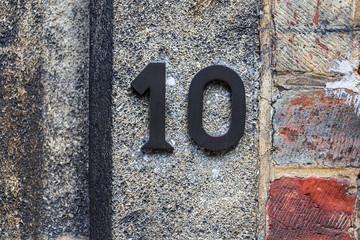 Number plate 10 at old brickwork, Brugge, Belgium