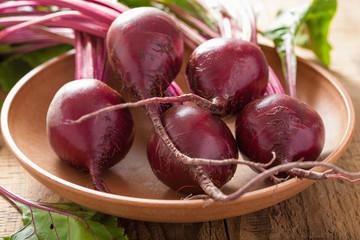 fresh beet in wooden bowl