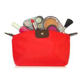 Various cosmetics in a red bag isolated on white