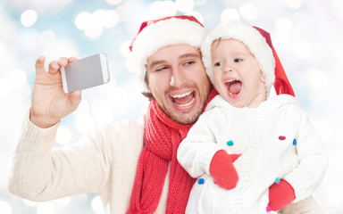 selfe  in winter. happy family dad and daughter