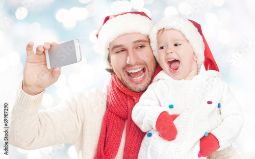 canvas print picture selfe  in winter. happy family dad and daughter