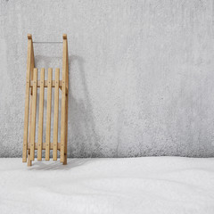 sledge on the wall with snow, winter background