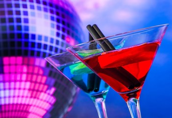 cocktail with sparkling disco ball background