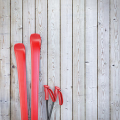 red blank skis on wooden planks wall
