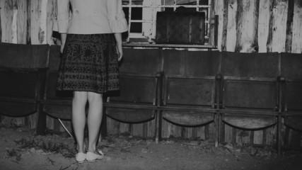 unrecognizable girl and retro vintage suitcase, travel concept