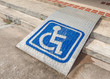 Ramped access, using wheelchair ramp with information sign on fl - 69988475