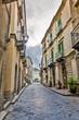 canvas print picture - Walking through Sicilian village.