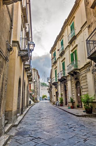 canvas print picture Walking through Sicilian village.