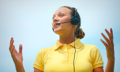 Beautiful call centre operator or client services office trying