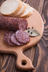 Italian salami sliced on wooden table