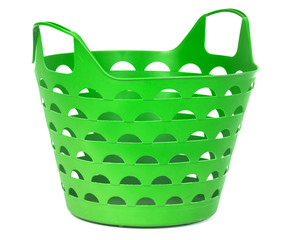 Green color plastic basket for supermarket shopping or laundry